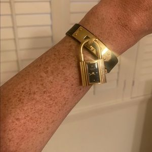 Hermes Accessories - Hermès black and gold kelly watch